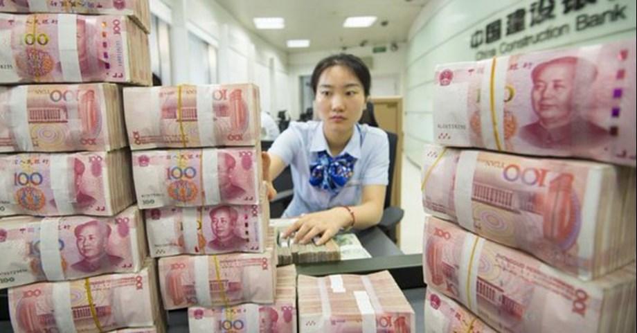 China's central bank sets daily yuan midpoint at its weakest since May
