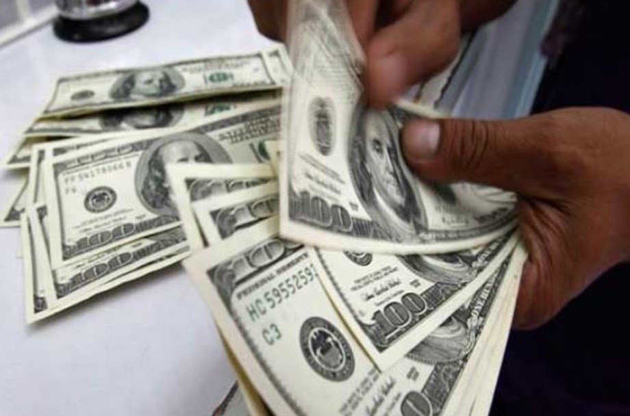 Dollar remains steady against basket of its peers