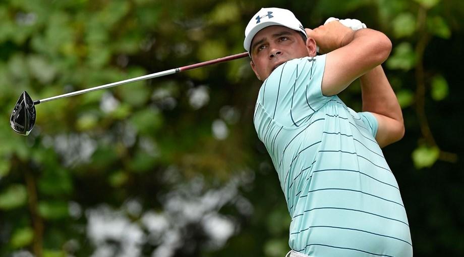 Woodland shoots 64 to seize PGA lead, Tiger, McIlroy grind to par