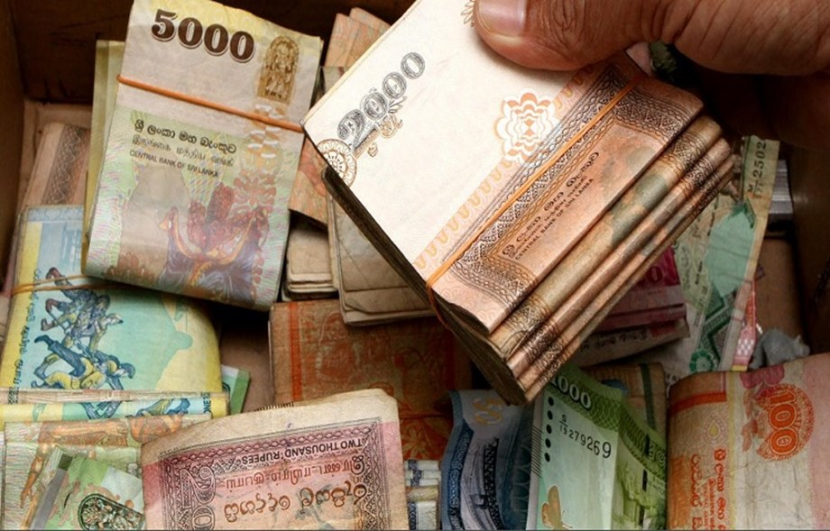 Sri Lankan currency hits record low against dollar, says dealers