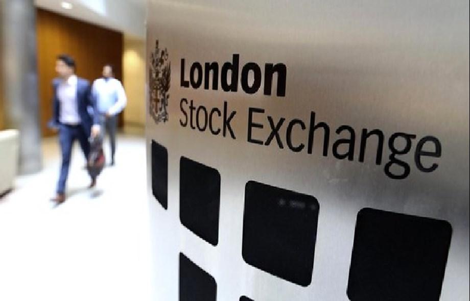 Britain's FTSE rises as pounds weakens; bid war hopes lift Inmarsat