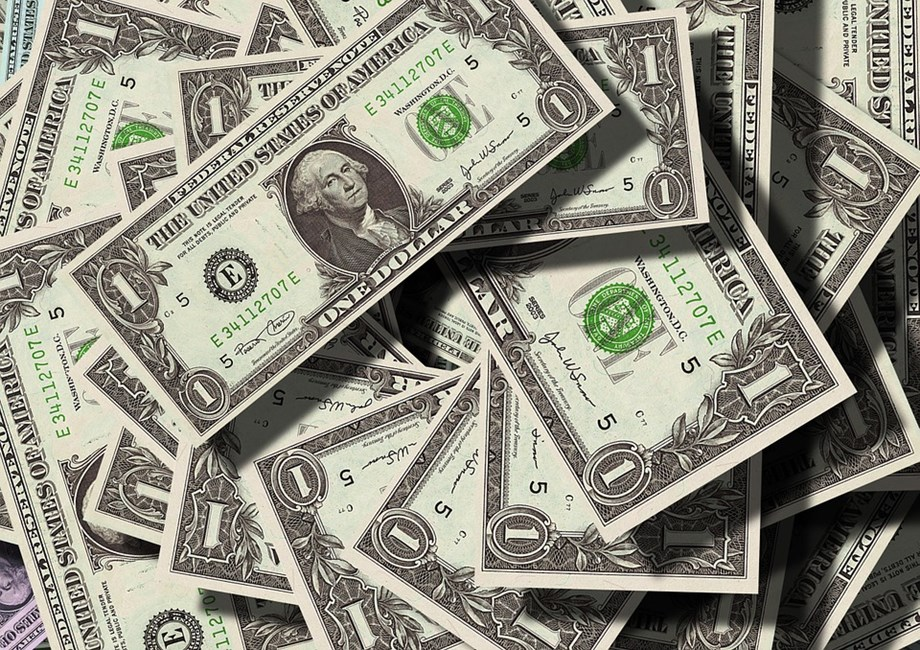 Trade data lifts U.S. dollar; stocks flat on mixed earnings