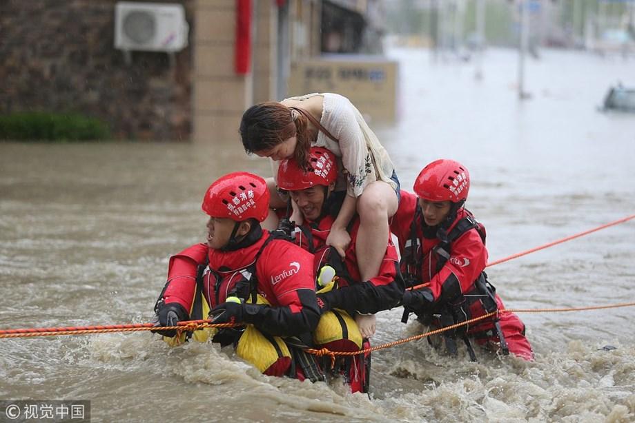 China floods wreak havoc, block roads and railways, more rain due
