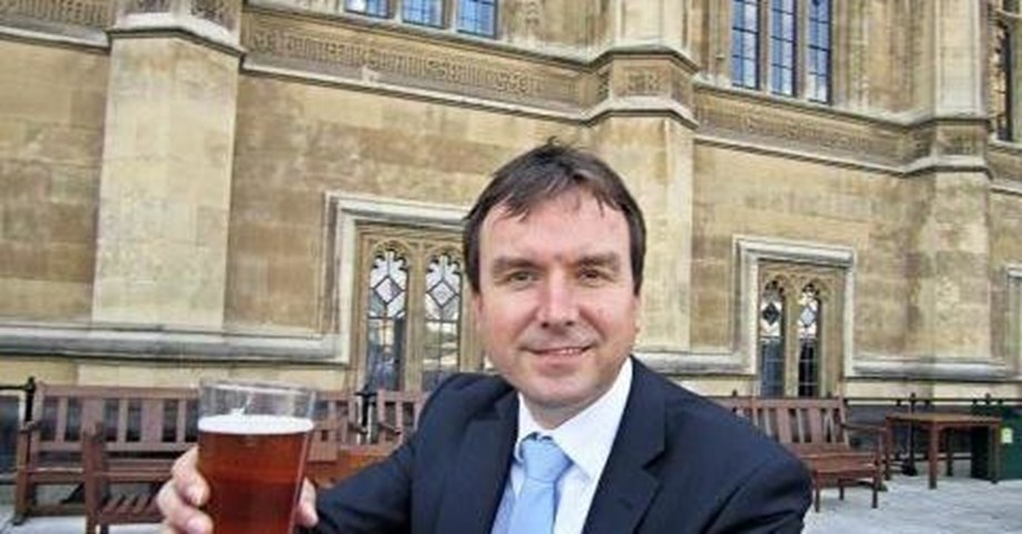 UK minister quits over lewd messages to barmaids