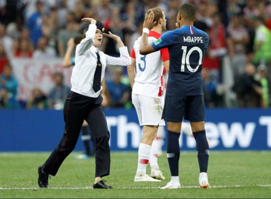 'Pussy Riot' members wore police uniforms in World Cup pitch invasion