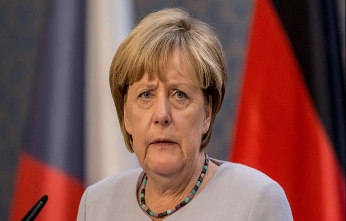Merkel's conservatives warn euro zone budget could split EU