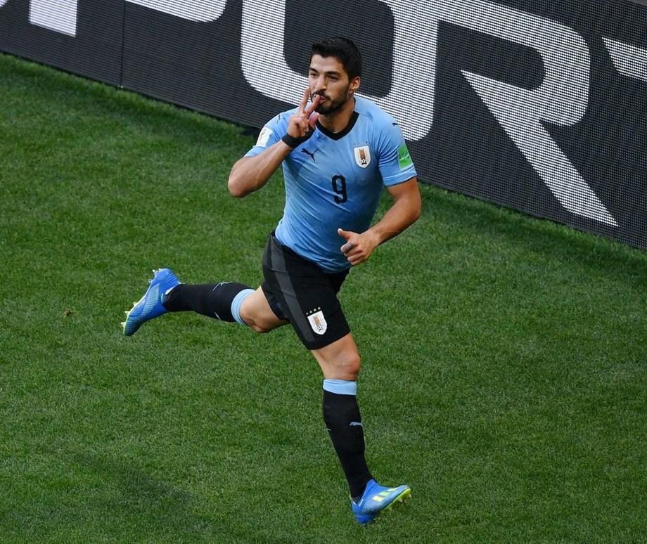 Suarez sends Uruguay into last 16 with hosts Russia