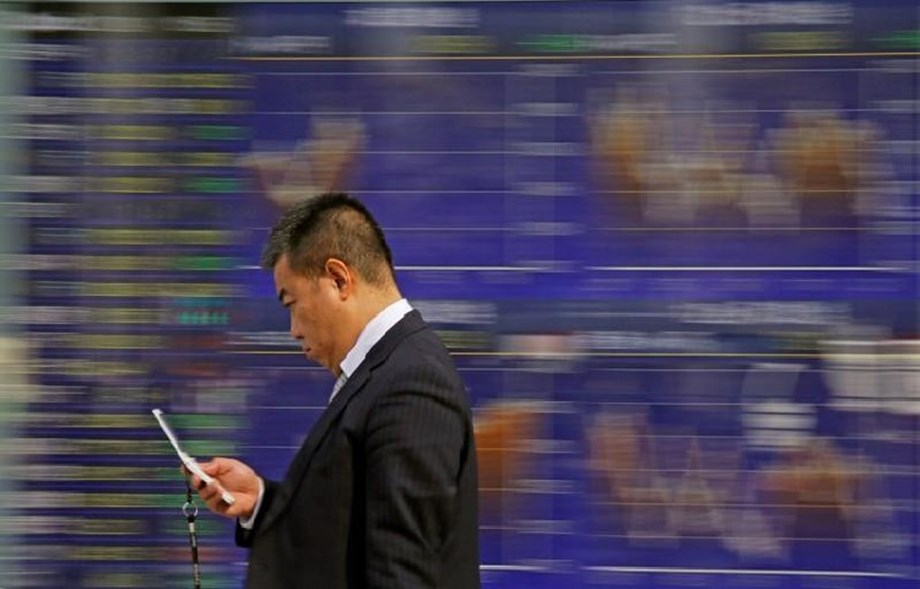 Asian shares subdued amid lull in trade spat, oil eases into OPEC