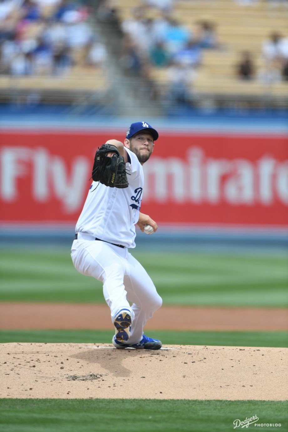 Los Angeles's Kershaw drove in pair of runs to help Dodgers beat Braves 4-1
