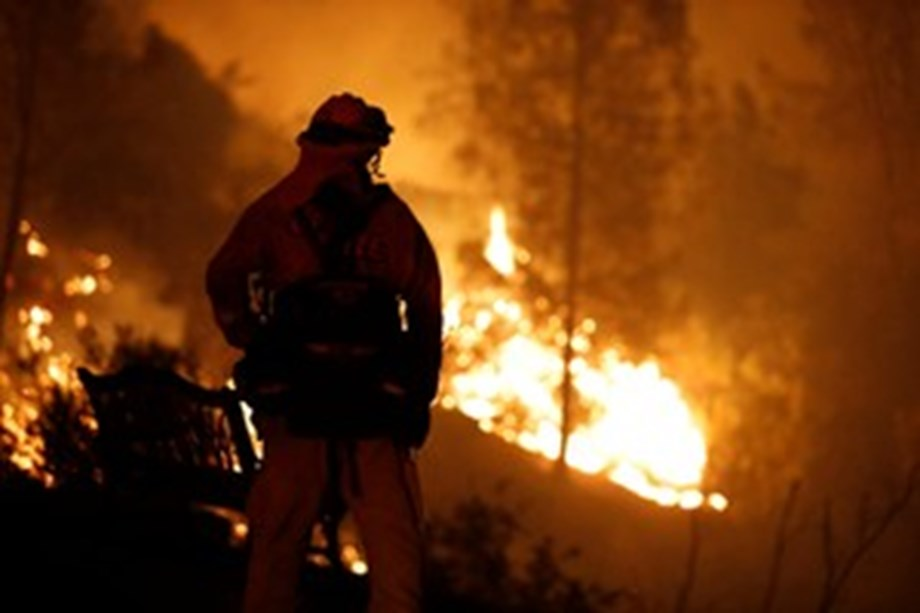 California wildfire causes mass evacuation, kills two firefighters