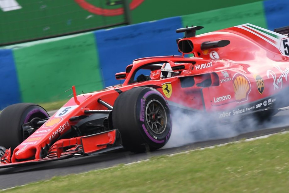 Motor racing-Vettel fastest in Hungary but Mercedes in a spin