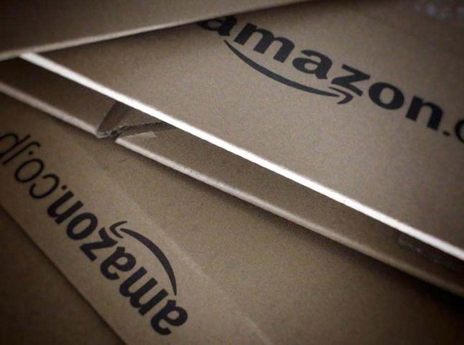 UPDATE 1-Amazon embraces U.S. government business, despite occasional controversy