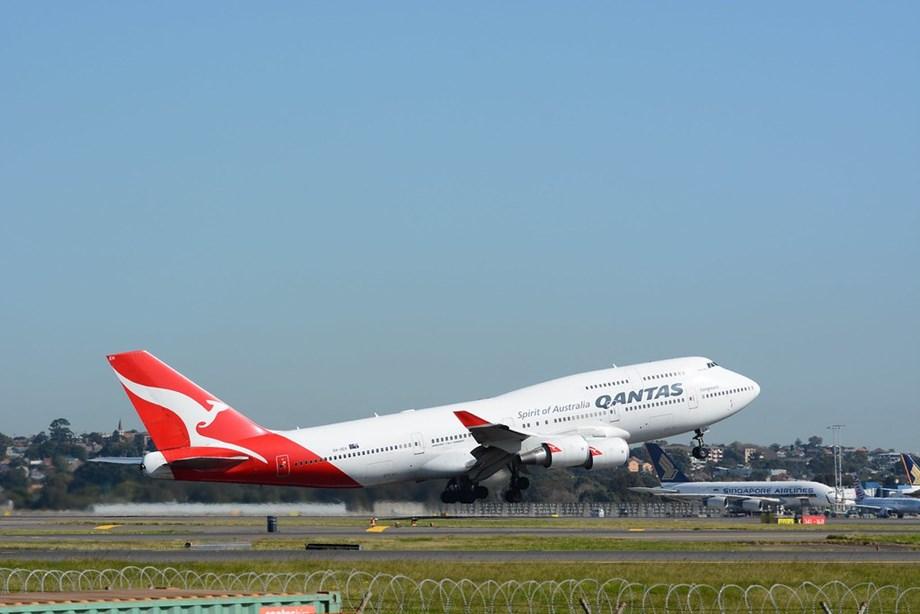 Passengers evacuate Qantas plane via emergency slides at Sydney airport