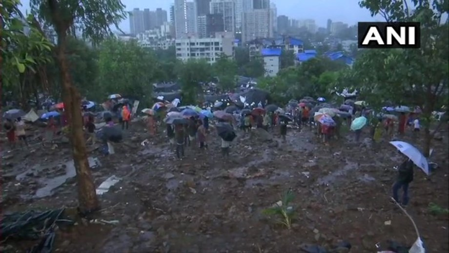 Heavy rains in India's Mumbai cause wall collapse that kills 13