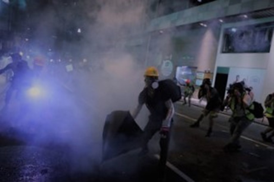 Twin rallies after tear gas clashes in Hong Kong tourist district