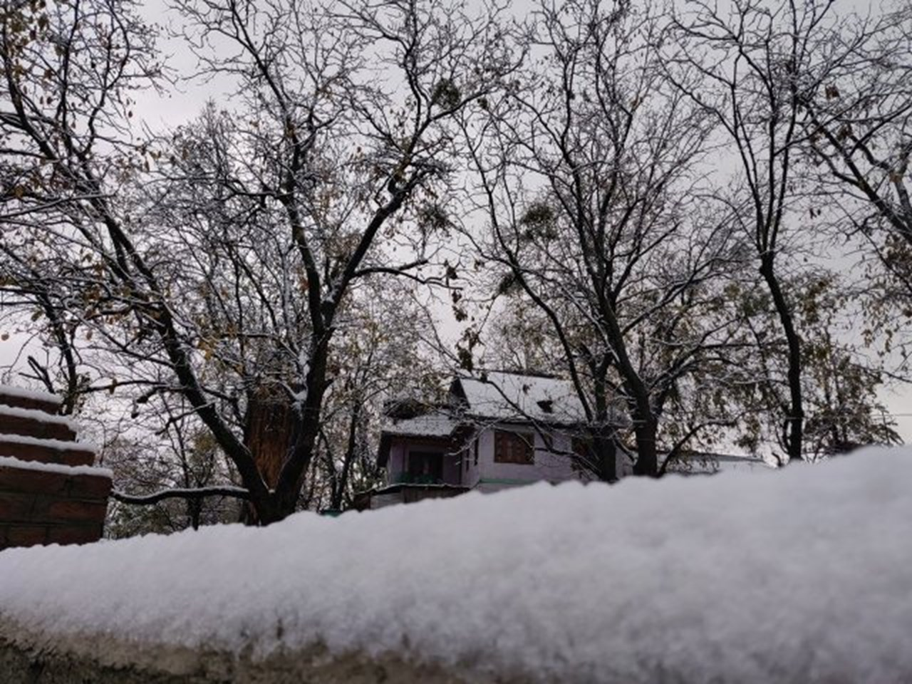 Srinagar and other plains of valley receive season's first snowfall
