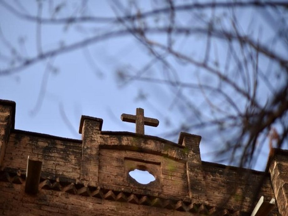 FEATURE-Tension heats up between church and villagers amid land ownership debate