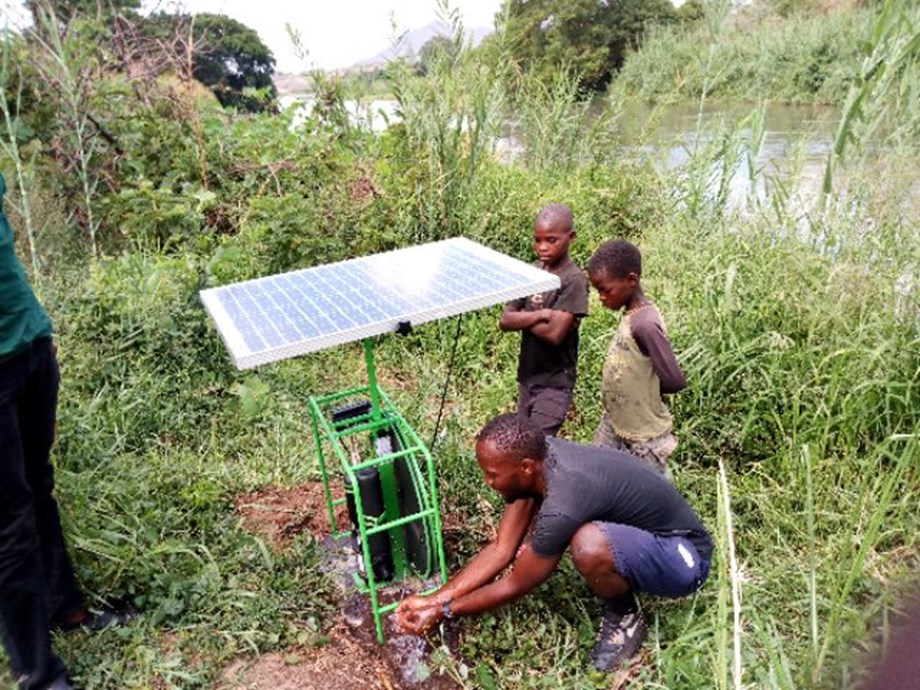 FEATURE-Solar-pumped water slakes rural Kenya's thirst for development