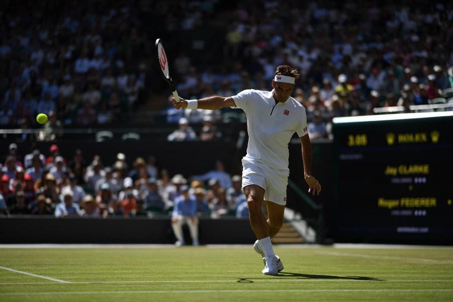 REFILE-Tennis-Federer overcomes shaky start to join Grand Slam 100 club