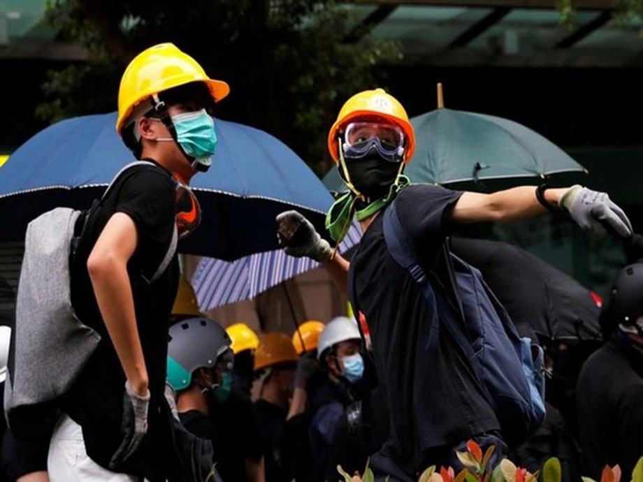 WRAPUP 2-Streets of Hong Kong become protest battlefield on China National Day