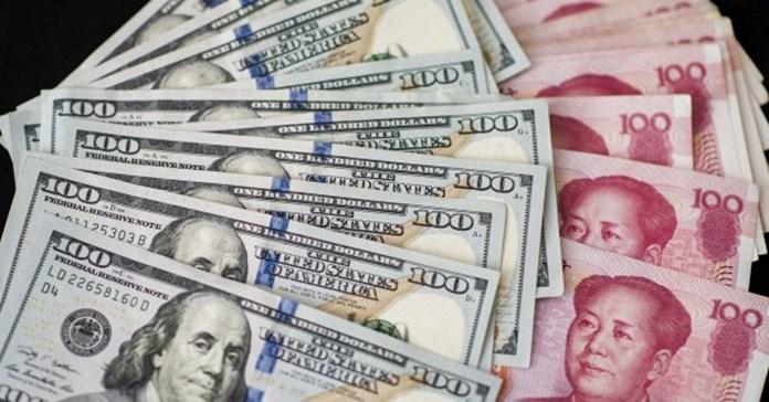 Dollar scales 16-month peak, yen edges lower