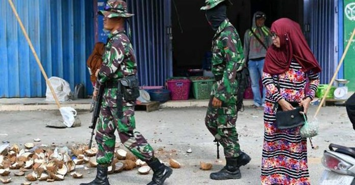 Indonesian security forces hunting Papua separatists suspected of killing 24 workers