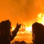 Tens of thousands evacuated as wildfires rage in California