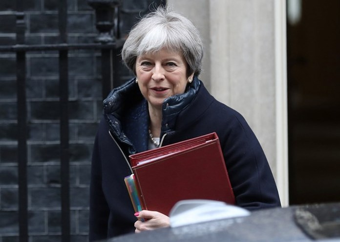 "UK PM's Conservative Party facing ""catastrophic split"" on Brexit plans"