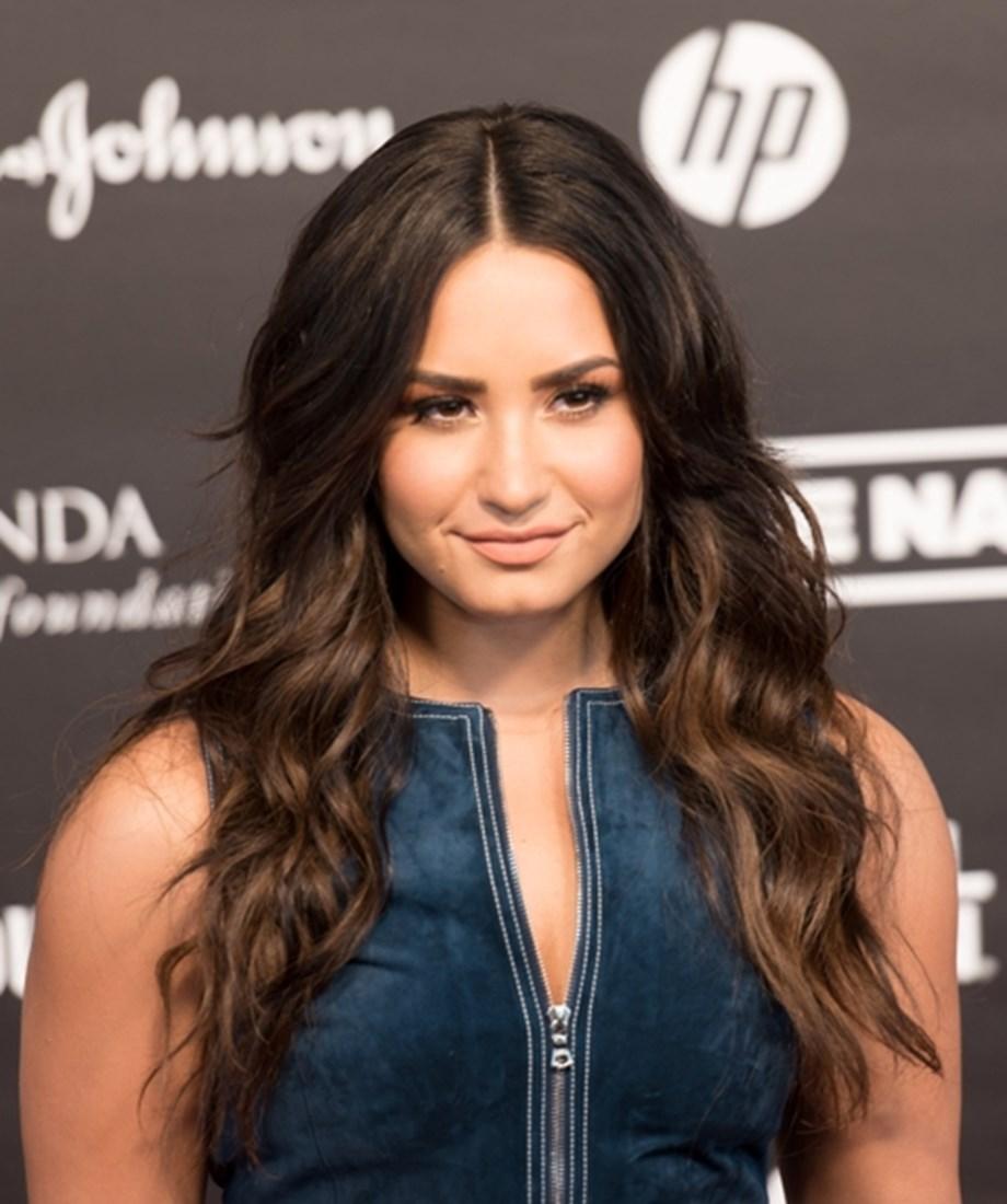 Singer Demi Lovato slams fan accusing her team of being 'rotten'