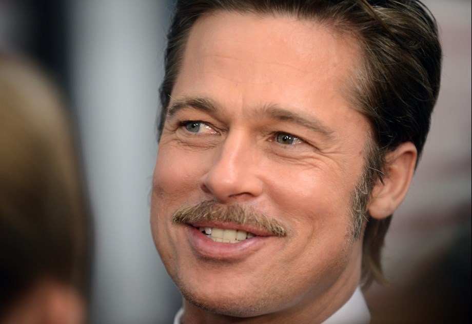CORRECTED-Who calls the tunes in space? Brad Pitt asks NASA astronaut