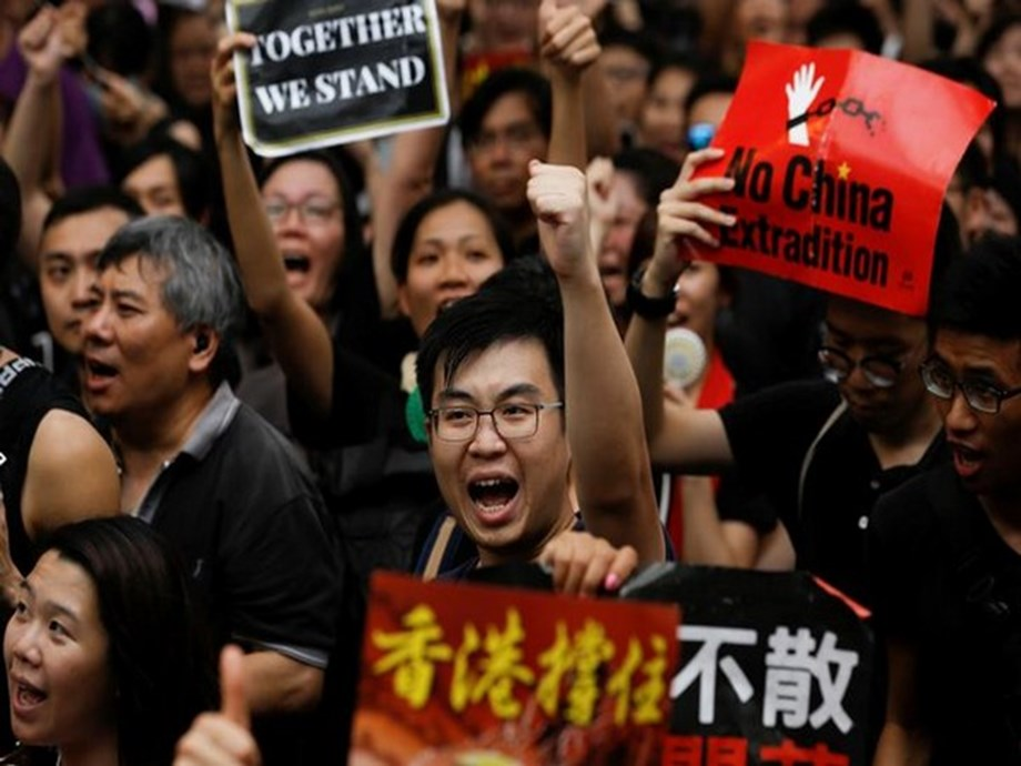 UPDATE 2-Protesters throng Hong Kong airport as property lobby calls for calm