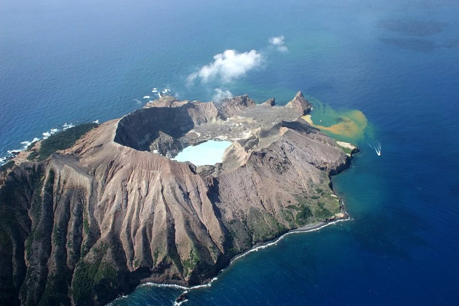 UPDATE 3-Hope fades for eight missing after New Zealand volcanic island erupts