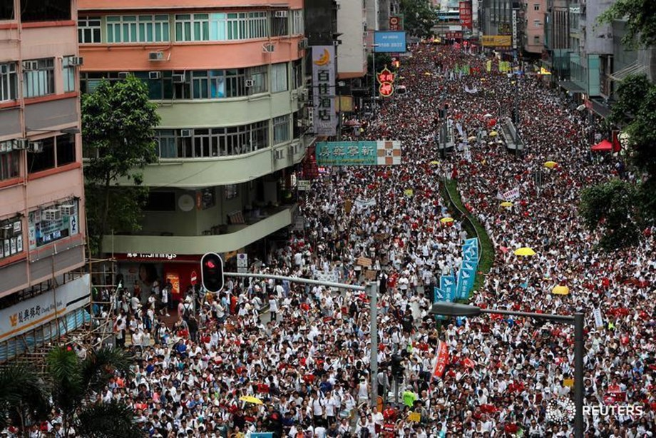 UPDATE 4-Hong Kong protesters march again, reaching out to Chinese visitors