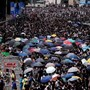 UPDATE 1-Hong Kong braces for protests as two critical after weekend clashes
