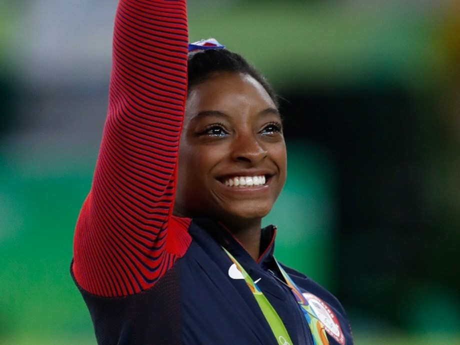 Gymnastics-American Biles wins vault gold to tie worlds medal record
