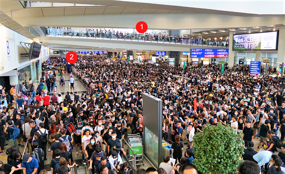 'An eye for an eye': sea of black at Hong Kong airport protest