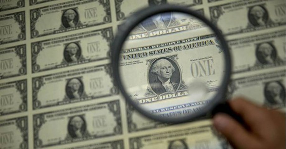US dollar traded near its lowest level in nearly two weeks, loss on Wall Street