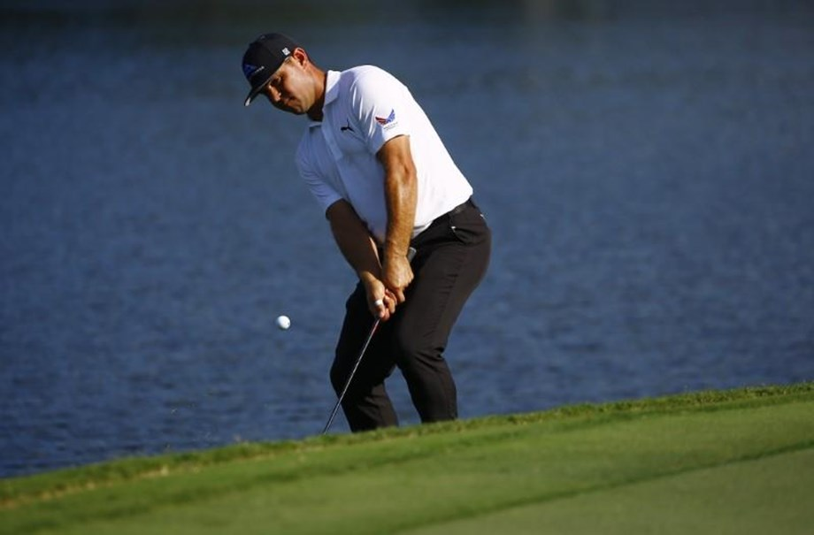 Gary Woodland ties course record to soar to joint halfway lead in CIMB Classic