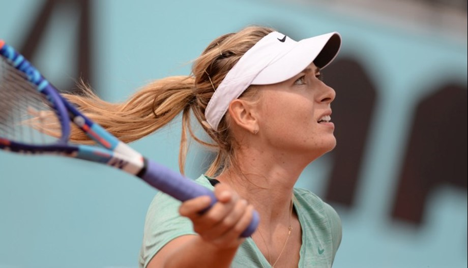 Sharapova begins her 15th Australian Open with 6-0, 6-0 win over Dart