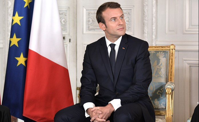 Macron seeks to end political turmoil as yellow vest protests affect business