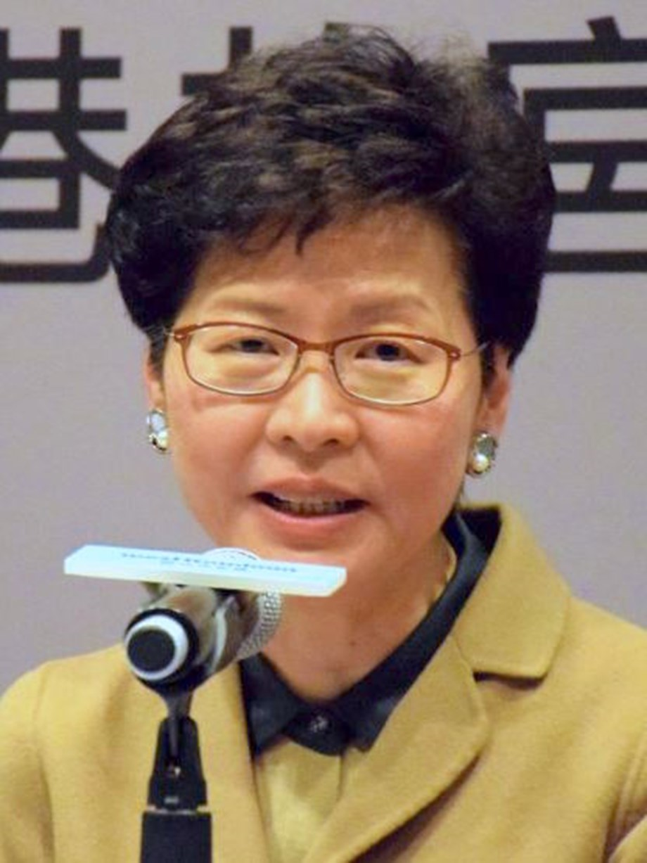 UPDATE 1-Hong Kong leader denies Beijing won't let her resign