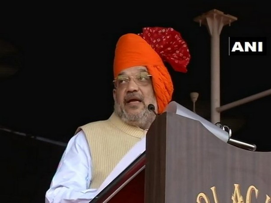 Shah targets Congress, says its leaders question move on removing intruders