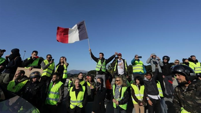 French government will take a hit of 2 billion euros by suspending fuel tax hike