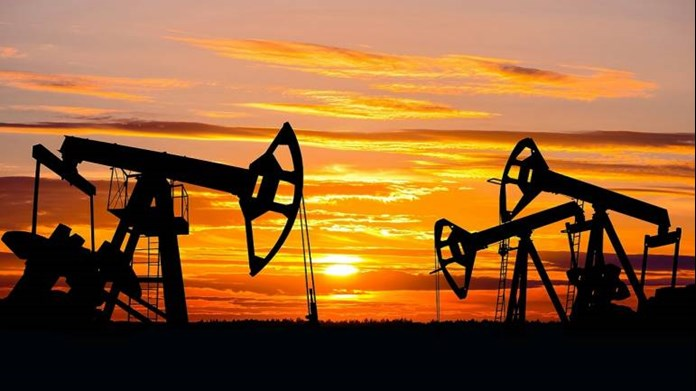 Oil majors help FTSE 100 rise, Next shines on brighter profit outlook