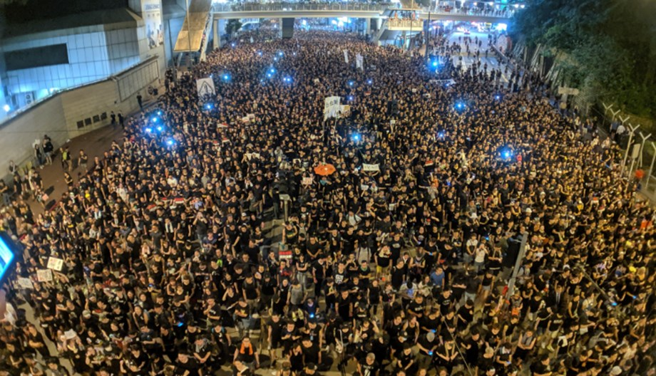 UPDATE 3-Hong Kong protesters, police clash as demonstrations target Chinese traders