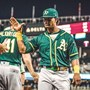 A's edge Mariners, clinch home field for wild-card game
