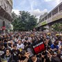 SPECIAL REPORT-In a working-class Hong Kong neighborhood, the protests hit home