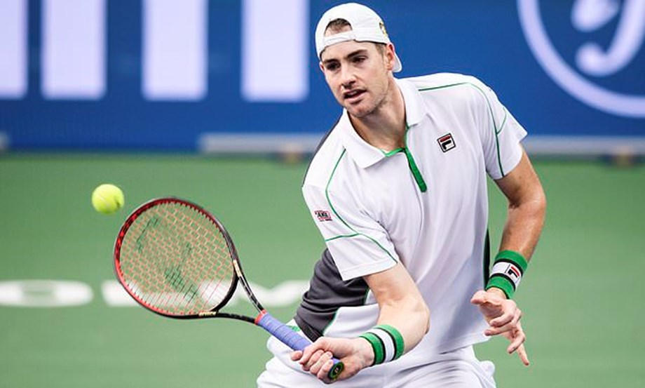 Australian Open: US number one Isner crashed out by taller Opelka