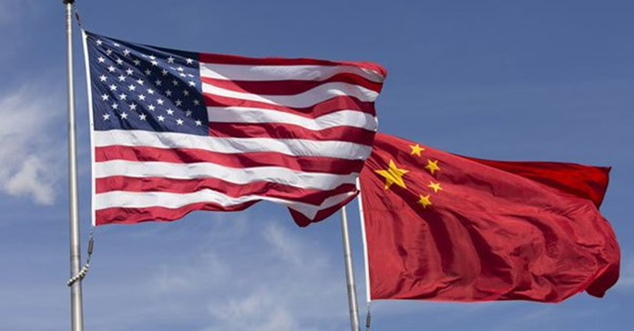 China-US negotiations difficult with 'gun to the head'