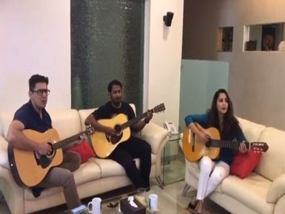 Madhuri Dixit showcases her musical craft by playing guitar